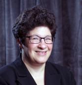 A head shot photograph of Liz Weintraub smiling